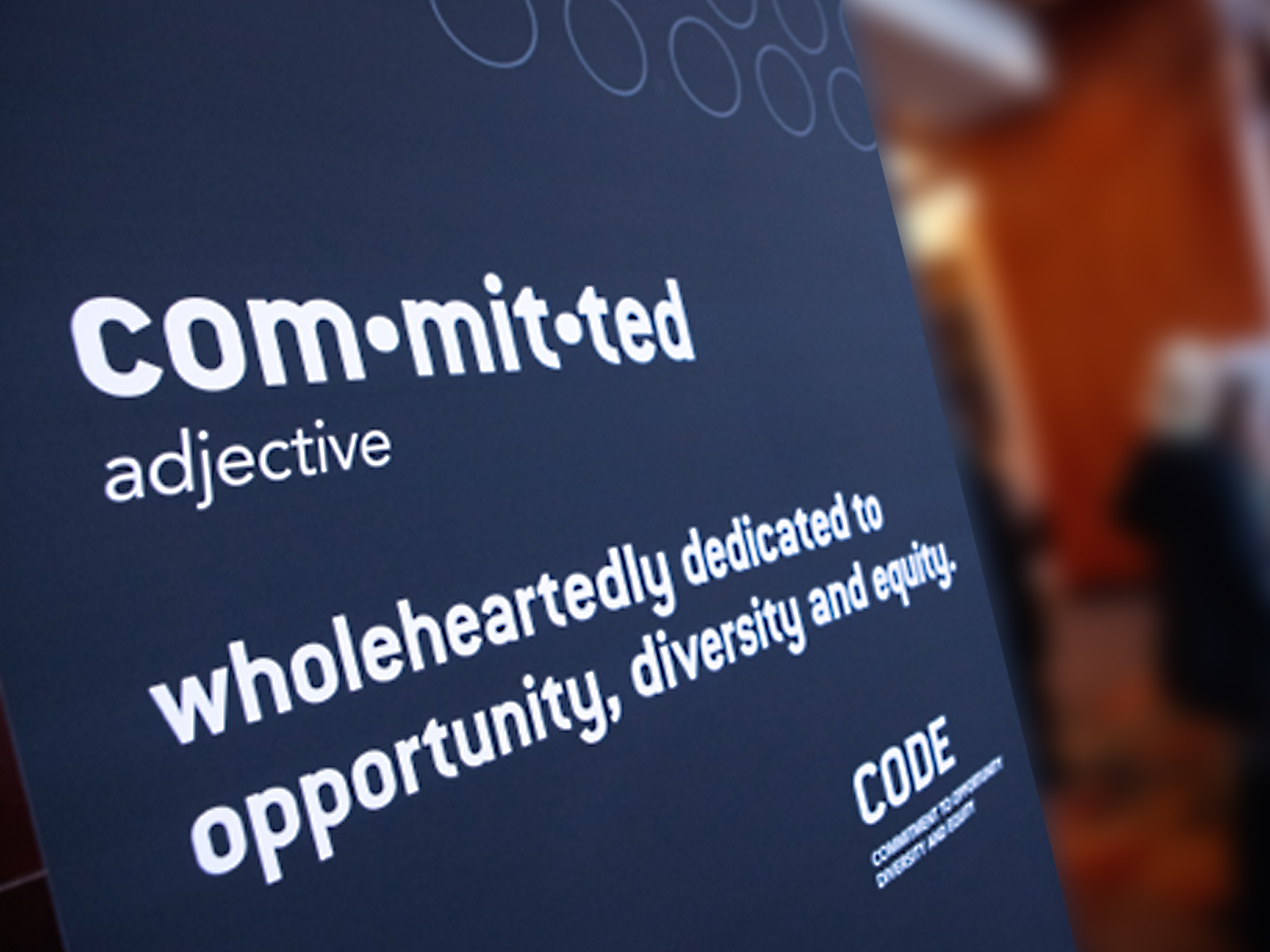 Poster with the word Committed at the top