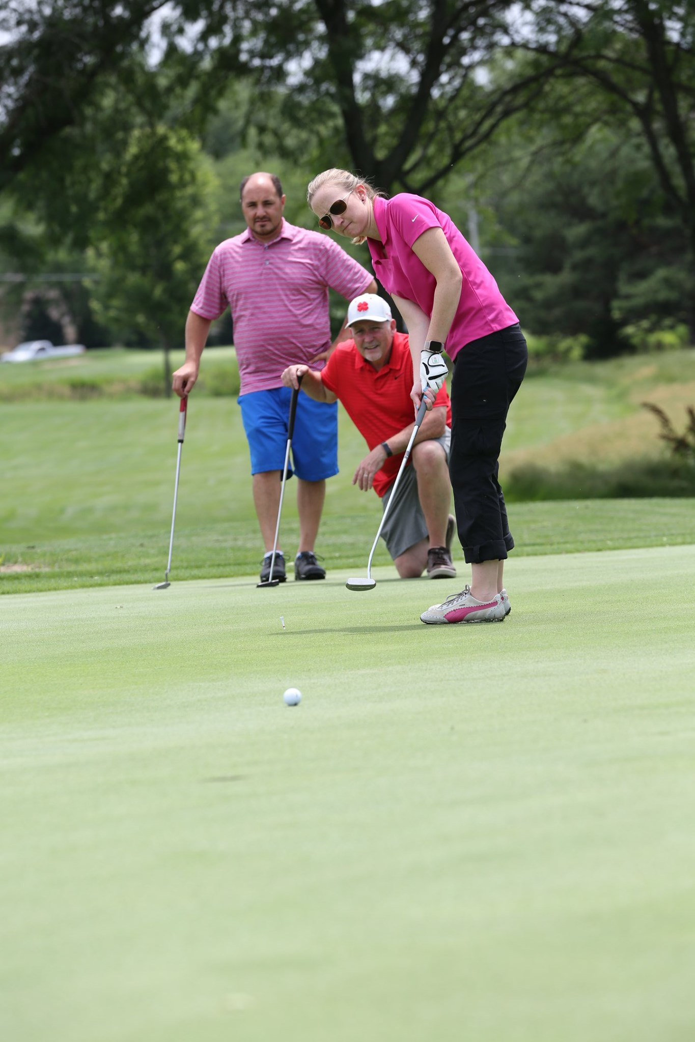 golfers at business on the green